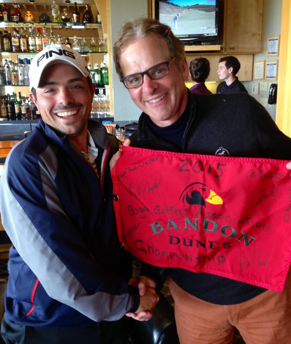 Alex Scarcella (left) presented with the Bandon Dunes flag by Don Drehoff