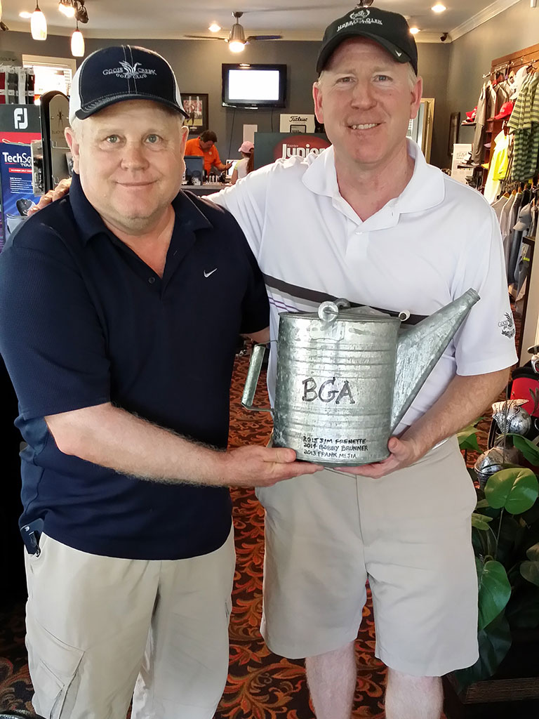 Bobby Brunner (left) presenting Water Can trophy to Jim Frenette (right)